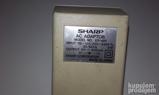 SHARP DC 6V-400mA +( spolja Trafo adapter